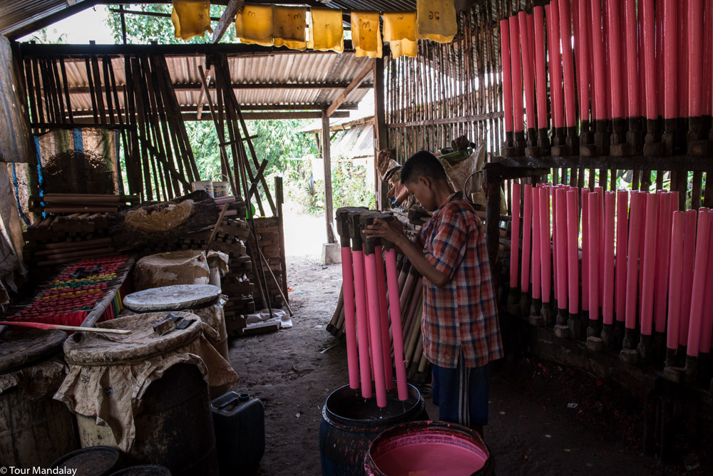 A worker coats the elastic bands in liquid rubber