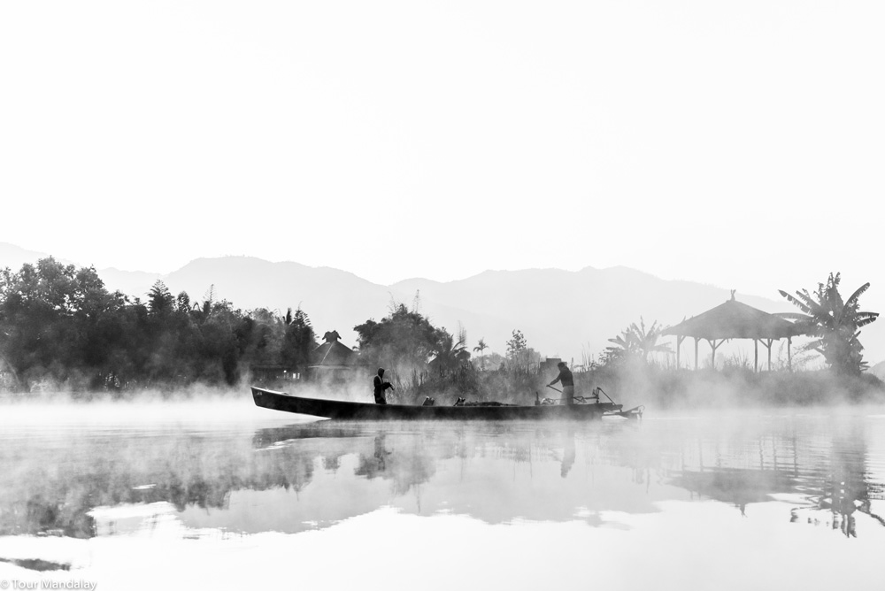 Local fisherman on a misty Inle