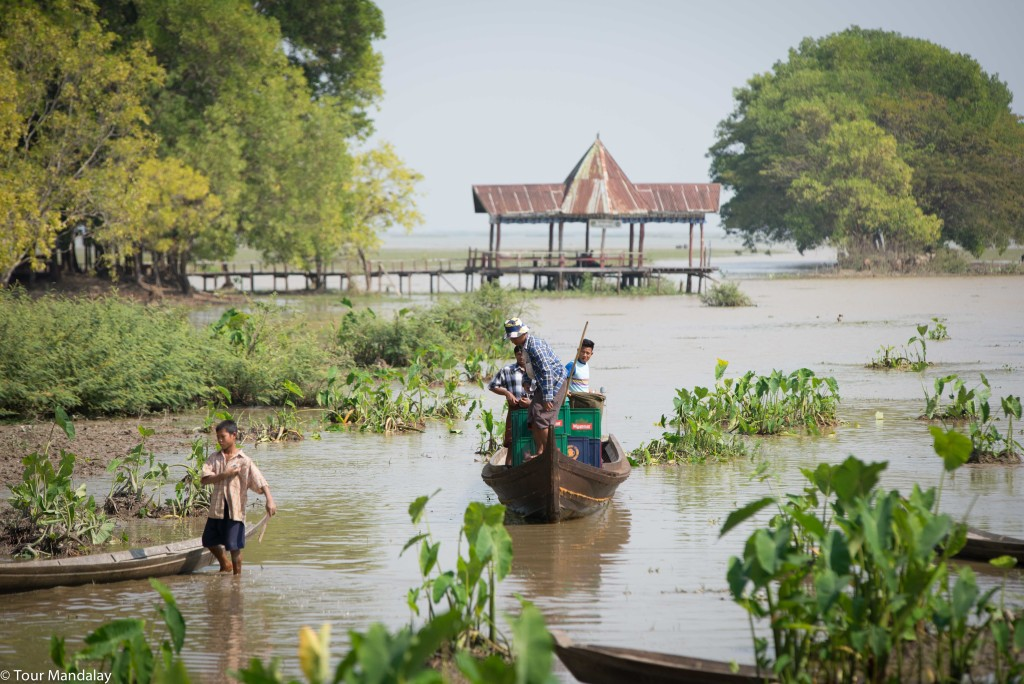 Locals ferry crates of Myanmar Beer to the nearby restaurants