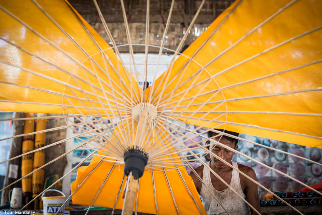 Man making traditional Myanmar parasol