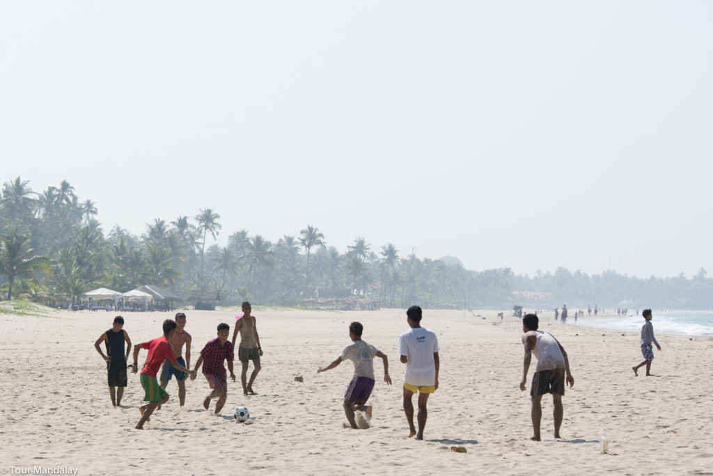 Locals play football in Ngwe Saung