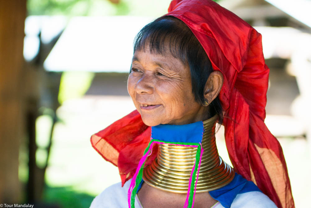 A 'long-necked' Kayan lady greets us with a smile