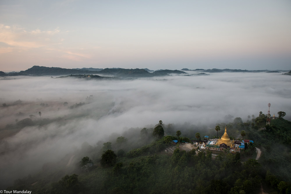 One of the areas' three hilltop temples overlooks the thick layer of mist