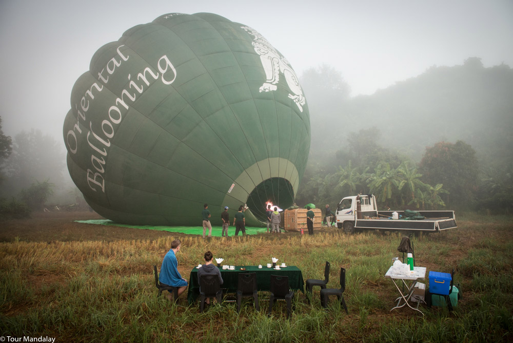 Tour Mandalay's team patiently wait for the balloon to inflate