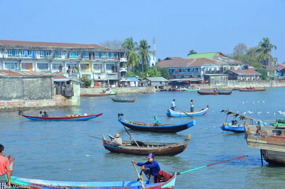 Boats make their way in and out of Sittwe's bustling port