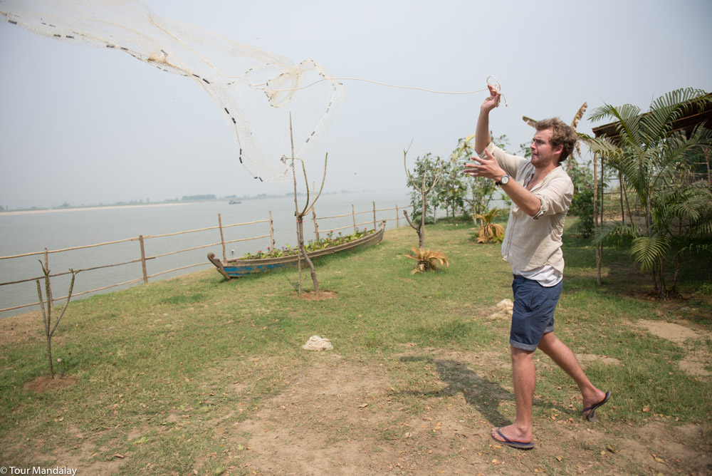 Tour Mandalay staff practise casting of net