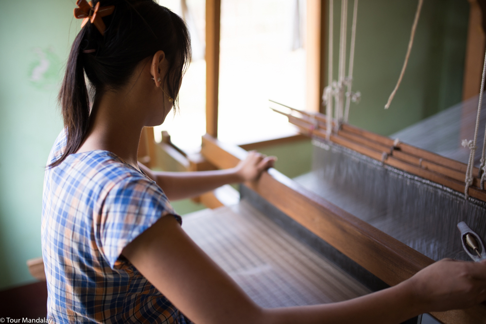 A lady from Sunflowers Organic Weaving beavers away on a traditional loom.