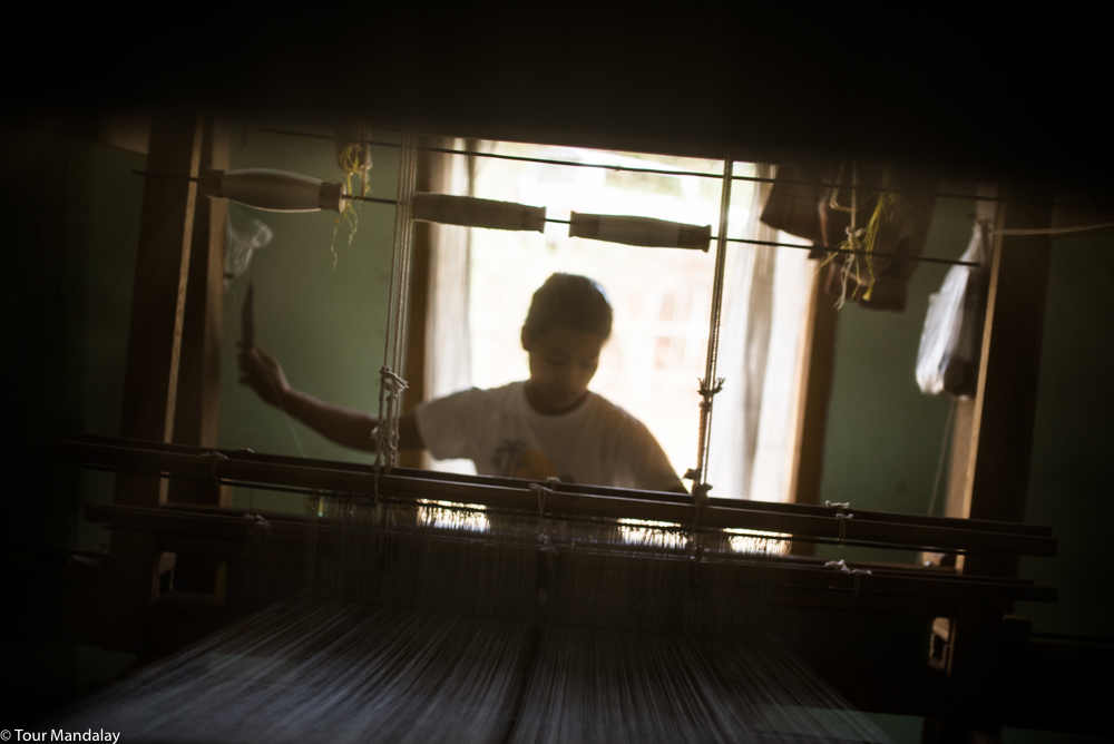 Weaving away like a magician on one of Sunflower's traditional looms