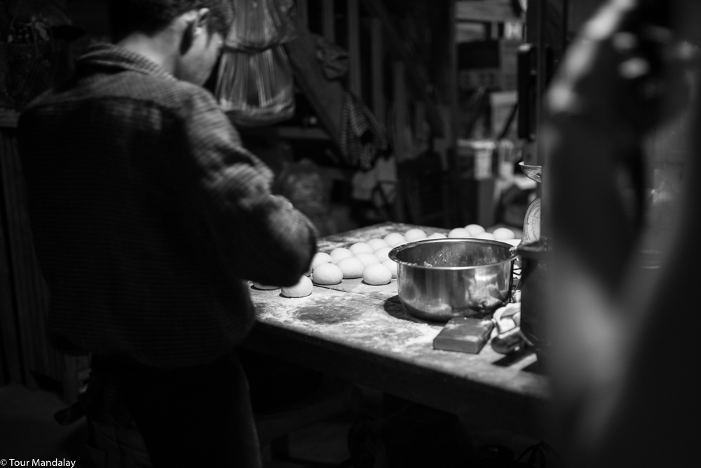 A cook prepares some fresh dumplings, which we came back to eat the next day