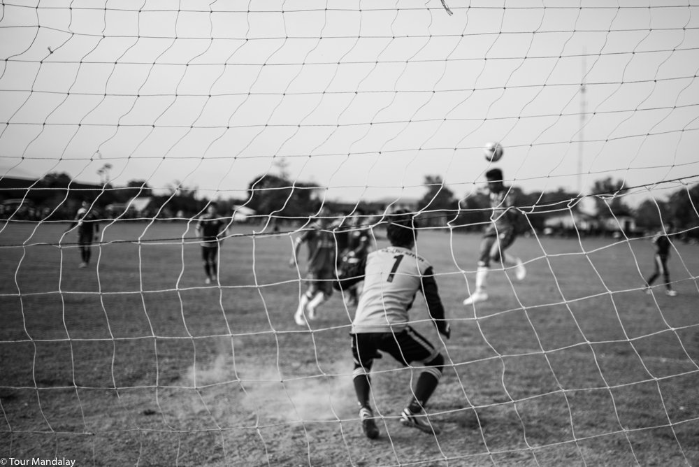 A striker heads the ball in a match versus Myitkyina and Phar Kant