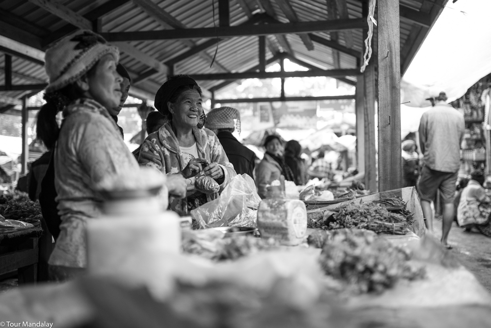 Two ladies greet us with glowing smiles as we walk past their vegetable stall