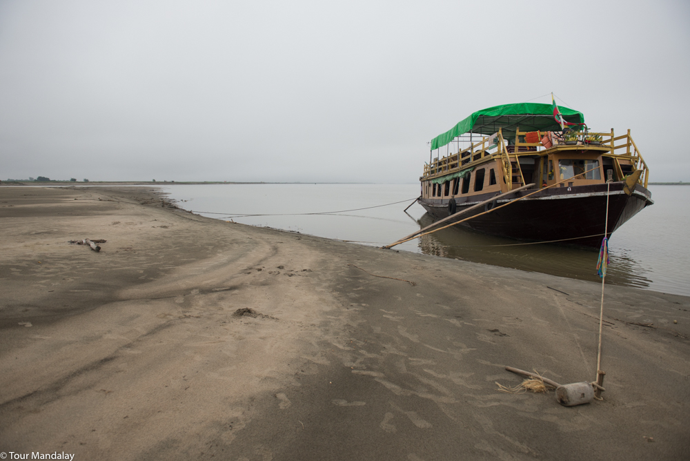 The boat moored up on a sandbank in the morning