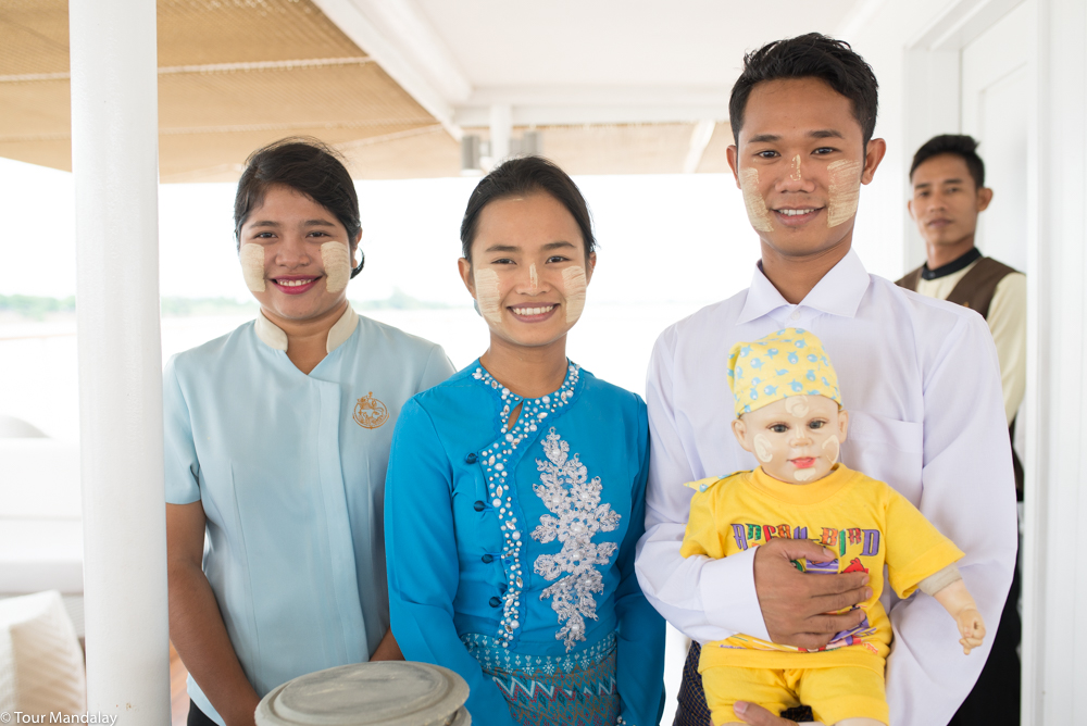 The Strand Cruise's ever-smiling staff with their thanaka model