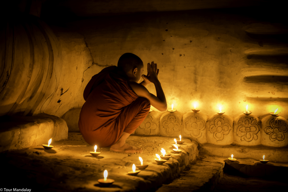 A novice monk paying his respects in Bagan